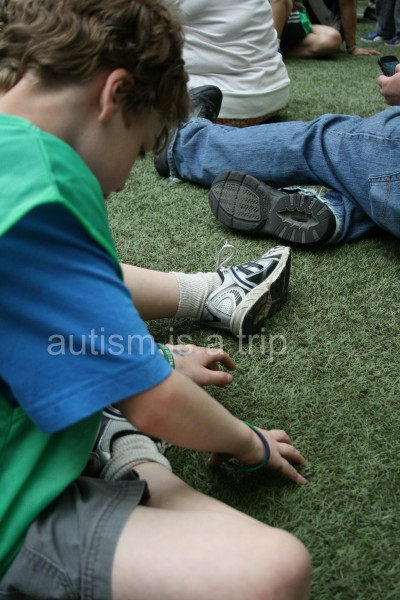 Waiting is tough, but astroturf is an awesome sensory experience.