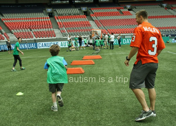 Running the ball with BC Lions defensive back Matt McGarva.