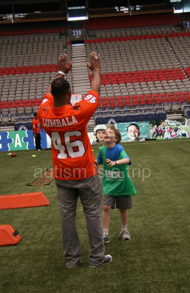 Going for a super-high 5 with BC Lions fullback Rolly Lumbala.